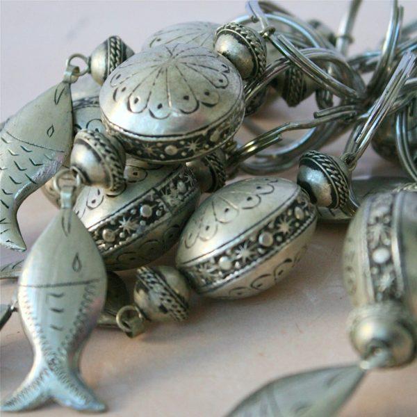 Silberner Schlüsselanhänger mit kleinem Fisch-0